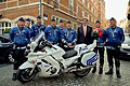 Kerry Poses with a Group of Belgian Motorcycle Officers who Provided Support for his Visit to a NATO Ministerial Meeting in Brussels (27153886895).jpg
