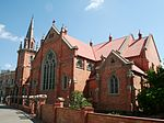 The external detail is Gothic. The fine red brick is typically 'Church and McLauchlin'. During the early 19th century, the Methodist congregation was supported by a group of people willing Type of site: Church Current use: Religious: Church. As a historical landmark in Kimberley, the Trinity Methodist Church complex is of compact design.