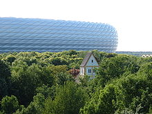 Allianz Arena with the Heilig-Kreuz-Kirche, the oldest church of Munich.