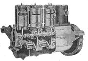 A 4-cylinder car engine of 1919, sectioned through the cylinders to show the Knight sleeve valves.