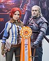 Kristina as Triss and Valery as Geralt from Witcher 3 at Igromir 2013 (10101539794).jpg