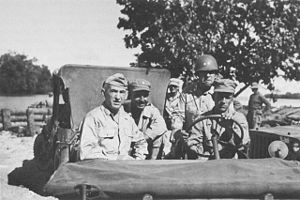 Innis P. Swift - Innis P. Swift (in helmet behind driver) with Generals Walter Krueger and William C. Chase