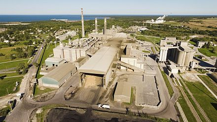 A factory, a traditional symbol of the industrial development (a cement factory in Kunda, Estonia) Kunda tsemenditehas.jpg