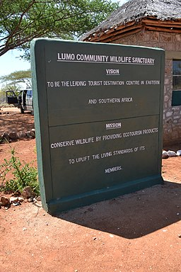 LUMO Community Wildlife Sanctuary vision and mission statement at the main gate in Kenya by CT Cooper (Christopher T Cooper)