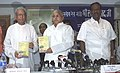 "Lalu Prasad releasing a book ""Gautam Budha and his Teachings"" written by Shri Anand Krishan, in New Delhi. The Minister of State for Railways, Shri R. Velu and the noted Hindi writer Prof. Namwar Singh are also seen.jpg"