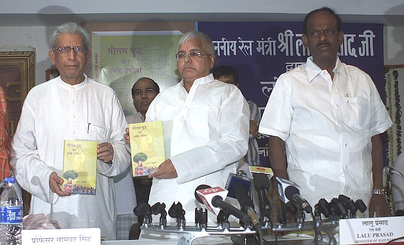 """File:Lalu Prasad releasing a book """"Gautam Budha and his Teachings"""" written by Shri Anand Krishan, in New Delhi. The Minister of State for Railways, Shri R. Velu and the noted Hindi writer Prof. Namwar Singh are also seen.jpg"""