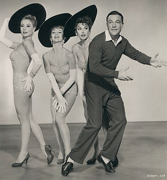 Cartwheel hat - Publicity still from Les Girls, showing classic cartwheel hats worn at a jaunty angle, 1957