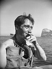 IWM photo of Lt. Lionel 'Buster' Crabb, RNVR, Officer in Charge of the Underwater Working Party at Gibraltar, dated April 1944
