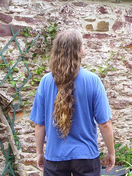 Cool long hairstyle for men. Male long hair in Western culture.