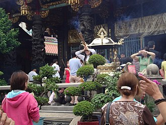 Veneration of the dead - Burning of incense during a veneration at Mengjia Longshan Temple, which is dedicated to Guan Yu, Mazu, and others