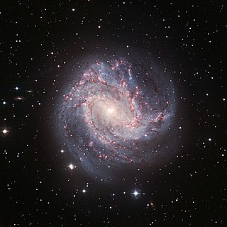 Intermediate spiral galaxy A galaxy that is in between the classifications of a barred spiral galaxy and an unbarred spiral galaxy