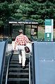 Man walking up an escalator.jpg