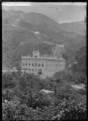 Mangahao Power Station, exterior view of the power station and penstocks on the hill above, 1924 ATLIB 301156.png