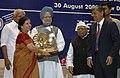 Manmohan Singh giving away the Special National Award for Women Entrepreneur in Micro & Small Enterprises to Smt. Savita Kailash Chhabra of Maharashtra, at the presentation of National Awards-2007 for Micro.jpg