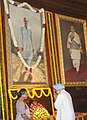 Manmohan Singh paying floral tributes at the portrait of former Prime Minister, late Shri Rajiv Gandhi, on his 69th birth anniversary, at Parliament House, in New Delhi. The Speaker, Lok Sabha, Smt. Meira Kumar is also seen.jpg