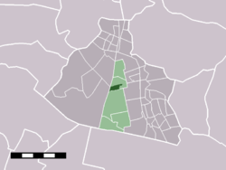 The town centre (dark green) and the statistical district (light green) of Westzaan in the municipality of Zaanstad.