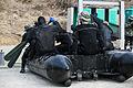 Marines use raiding craft for simulated beach demolition 150209-M-RZ020-004.jpg