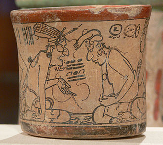 Maya priesthood - High priest (aj k'in), evincing the eye of Kinich Ahau Itzamna and the netted headdress of the Bacabs, while instructing scribes