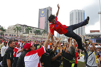 Hari Merdeka - A man is thrown into the air by a crowd during Merdeka Day celebrations in Merdeka Square, Kuala Lumpur, 2008
