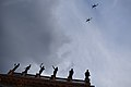 Military helicopters fly over Teatro Juarez.jpg