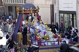 Mardi Gras in the United States - King Felix III and the queen of the Mobile Carnival Association aboard the MCA crown float on Royal Street during the 2010 season