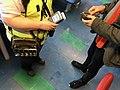 Mobile portable ticket sale debit and credit card payment machine reader, money bag with money changer coin dispenser, etc. for ticket sale on car ferry (billettkjøp på bilferge). Venjaneset-Hattvik line, Hordaland, Norway 2018-03-21.jpg