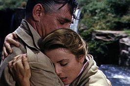 Scène met Clark Gable en Grace Kelly.