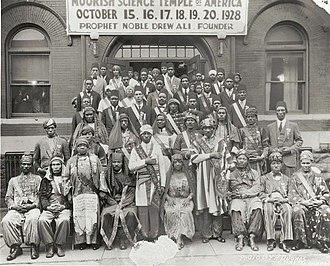 Moorish Science Temple of America - Attendees of the 1928 Moorish Science Temple Conclave in Chicago. Noble Drew Ali is in white in the front row center.