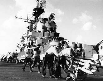 Formosa Air Battle - Crewmen on USS Hancock (CV-19) move rockets to planes while preparing for strikes on Formosa, 12 October 1944.