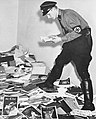NAZI reading before burning the library of Dr. Hirschfeld, Institute for Sexual Research, Berlin, 6 May 1933- Institut für Sexualwissenschaft - Bibliothek 1933 (cropped).jpg