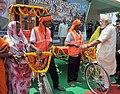 Narendra Modi interacting with the beneficiaries of E-Rickshaw and Paddle Rickshaw Package and their families, at the function organised by the Rickshaw Sangh, at Varanasi, Uttar Pradesh on September 18, 2015 (1).jpg