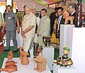 Narendra Modi visits an exhibition on the venue for foundation stone laying ceremony of Trade Facilitation Center and Crafts Museum and Inauguration of Powerloom Service Center, at Varanasi.jpg