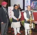 Narendra Singh Tomar lighting the lamp at the ASSOCHAM Steel Summit, in New Delhi on November 13, 2014. The Minister of State for Mines and Steel, Shri Vishnu Deo Sai is also seen.jpg