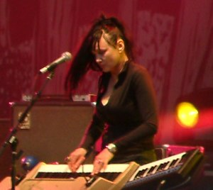Natasha Shneider - Natasha performing with Queens of the Stone Age, 2005