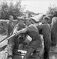 Newfoundlanders loading 6 inch gun UK WWII IWM D 8883.jpg