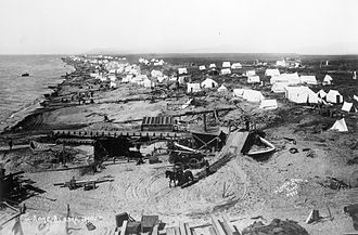 Nome Gold Rush - View of beach west of Nome, 1900. Tents and mining equipment are seen.