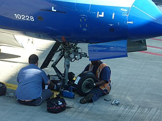 Aircraft maintenance technician - Technicians replace front wheels on a United Express Bombardier CRJ700 aircraft at Chicago O'Hare International Airport