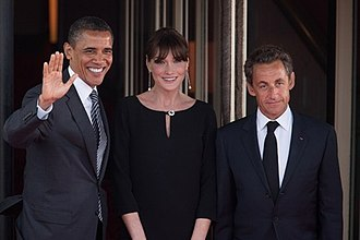 Nicolas Sarkozy - Sarkozy and his wife Carla Bruni greet President Barack Obama at the G8 Summit dinner in Deauville, France, 26 May 2011.