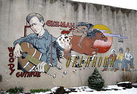 Guthrie has continued to remain popular decades after his death; this mural was painted in his hometown of Okemah in 1994 Okemah mural.jpg