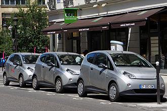 Autolib' - Bolloré Bluecars recharging at an Autolib' service kiosk on Rue du Quatre Septembre, Paris, in June 2012.