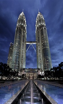 Night view of the Petronas Twin Towers with waterworks. Picture taken to give a ground observer's view.