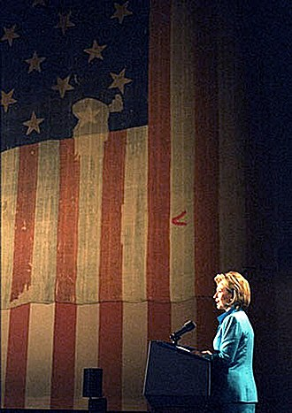 Save America's Treasures - Hillary Clinton in front of the Star Spangled Banner, one of the first Save America's Treasures Projects, 1998