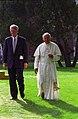 Photograph of President William J. Clinton and Pope John Paul II Walking through the Courtyard of Regis University in Denver, Colorado - NARA - 3164809.jpg
