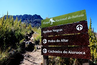 Pico das Agulhas Negras - Tourist information signs in Itatiaia National Park close to Pico das Agulhas Negras, with the peak in the background.