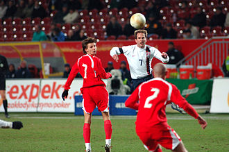 Euzebiusz Smolarek - Smolarek challenging for the ball against Eddie Lewis of the United States in a March 2006 friendly