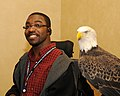 Posing for picture with Bald Eagle. (10593939066).jpg