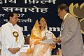 Pratibha Devisingh Patil presenting the Award to Shri Subhash Ghi, Producer for the Best Film on Other Social Issues such as Prohibition, Women and Child Welfare, Anti-Dowry, Drug Abuse.jpg