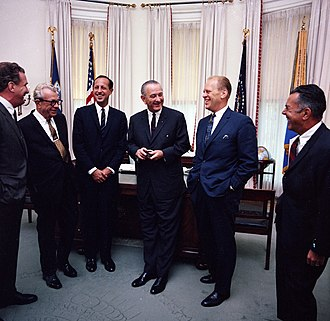 90th United States Congress - President Johnson with NFL owners and Republican Congressional leaders, June 7, 1967. L-R: Edward Bennett Williams (President of the Washington Redskins), Senator Everett Dirksen, NFL Commissioner Pete Rozelle, President Lyndon B. Johnson, Rep. Gerald Ford, unidentified (probably Rep. John W. Byrnes)