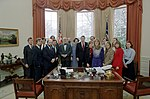 President Ronald Reagan Farewell Photo Opportunity with Lyn Nofziger Departing Assistant for Political Affairs and Members of His Staff Including Lee Atwater and Ed Rollins in Oval Office.jpg