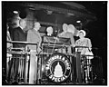 President departs on transcontinental trip. Washington, D.C., July 7. President Roosevelt was in a happy mood tonight as he boarded his special train for a transcontinental trip which will LCCN2016873612.jpg